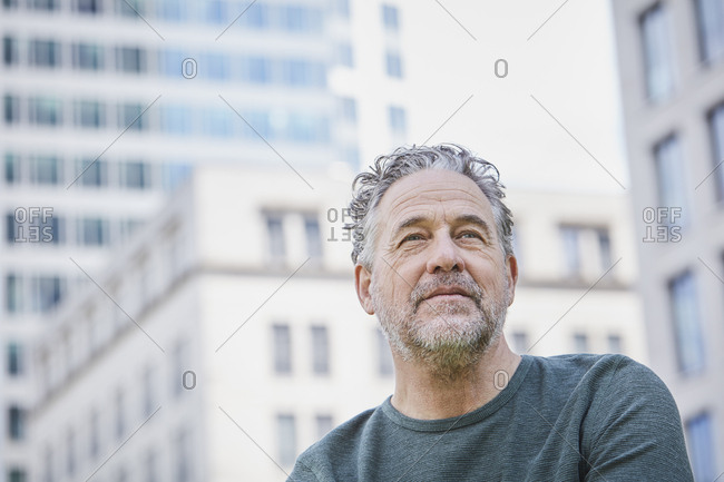 Portrait of confident mature man in the city looking up