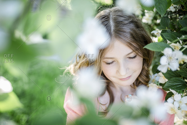 Portrait of girl with closed eyes in the garden