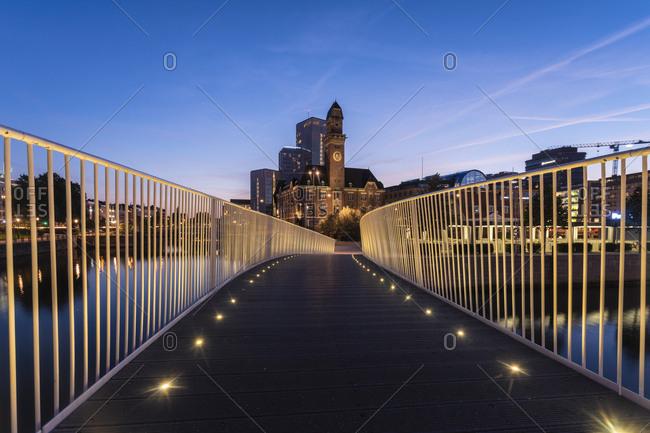 September 2, 2018: Illuminated footbridge against sky in city at night