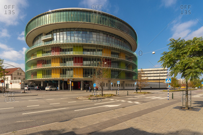 September 3, 2018: Modern glass building by street against sky in city