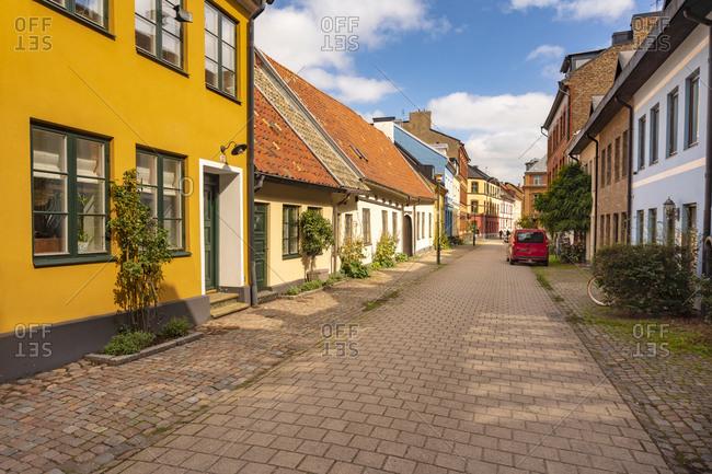 Street amidst residential buildings in city