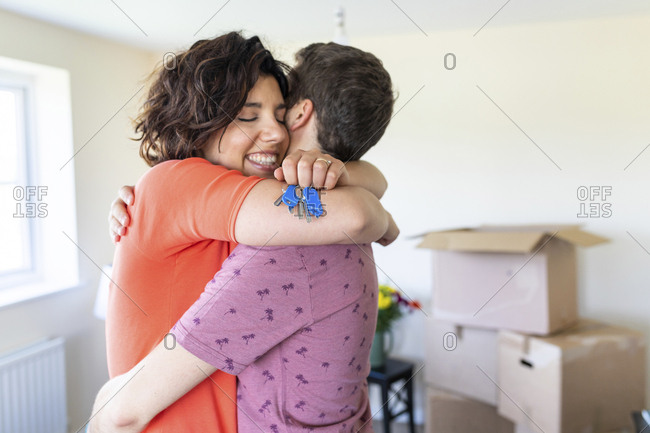 Happy couple hugging in new home