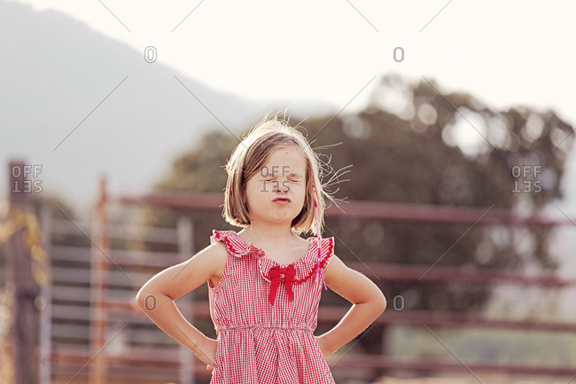 Portrait of little girl with eyes closed pouting mouth