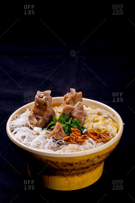 Warm bowl of ribs with noodles
