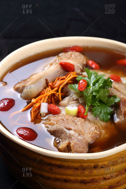 Warm bowl of ribs in soup