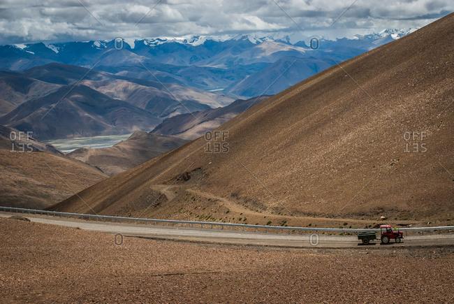Truck drives through mountains