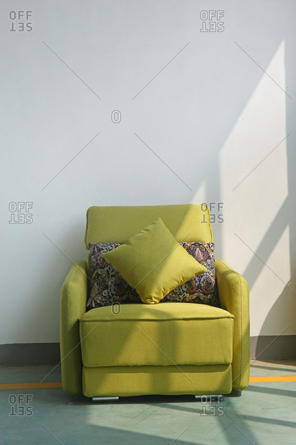 Green recliner in a room