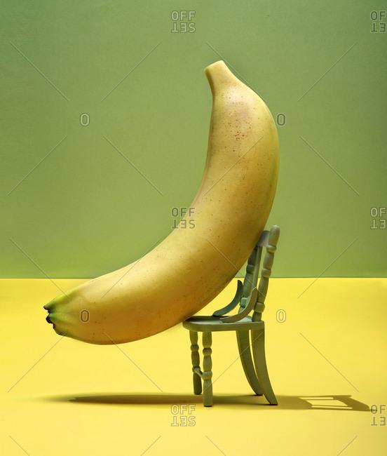 Banana on small green chair