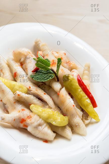Chicken feet on plate