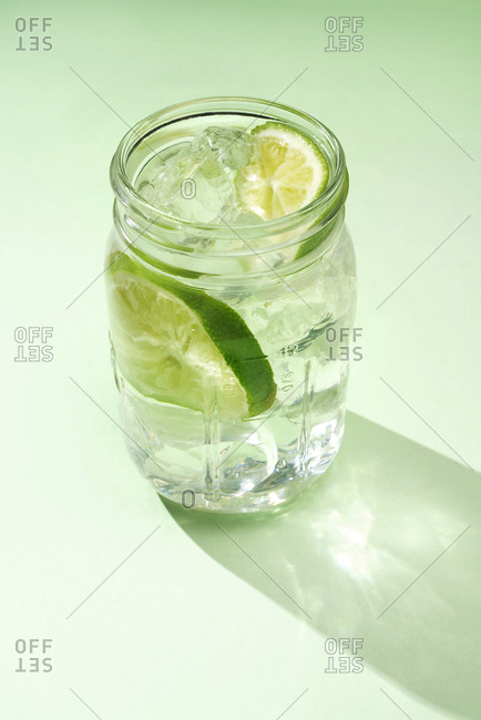 Glass of water and limes