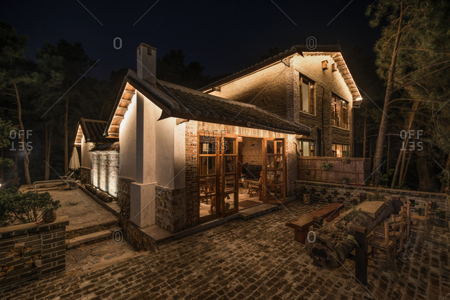October 12, 2019: Home stay facility houses in the mountains at night, Qingyuan City, China