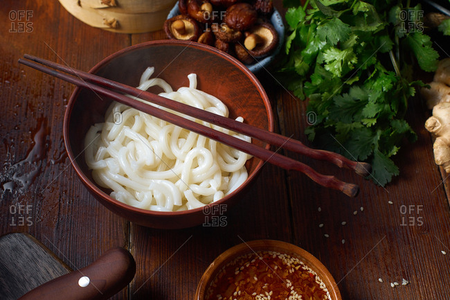 Asian food ingredients on wooden background. Cooking ramen with shiitake