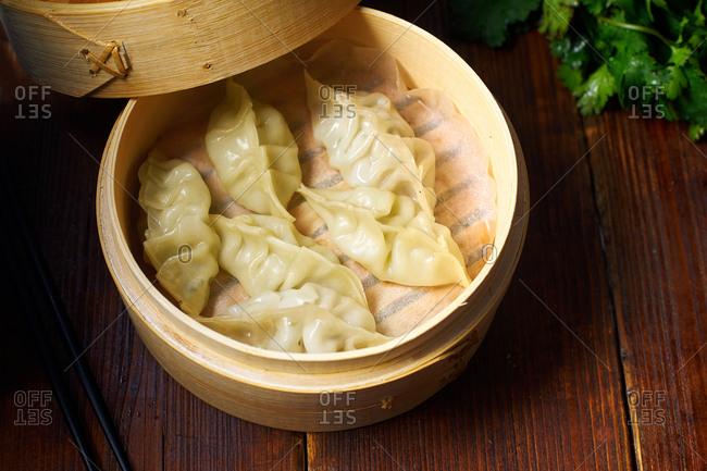 Pork gyoza dumplings in a bamboo steamer