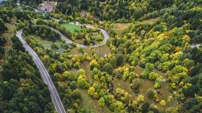 Aerial view over landscape with winding road in autumn