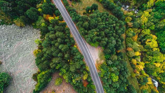 Aerial view over rural landscape with highway in autumn