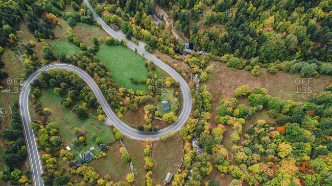 Winding road leading through countryside in autumn