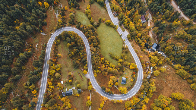 Aerial view over road leading through countryside in autumn