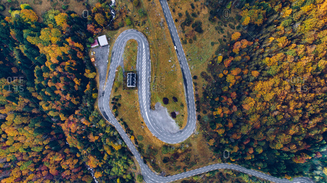 Aerial view over winding road leading through countryside in autumn