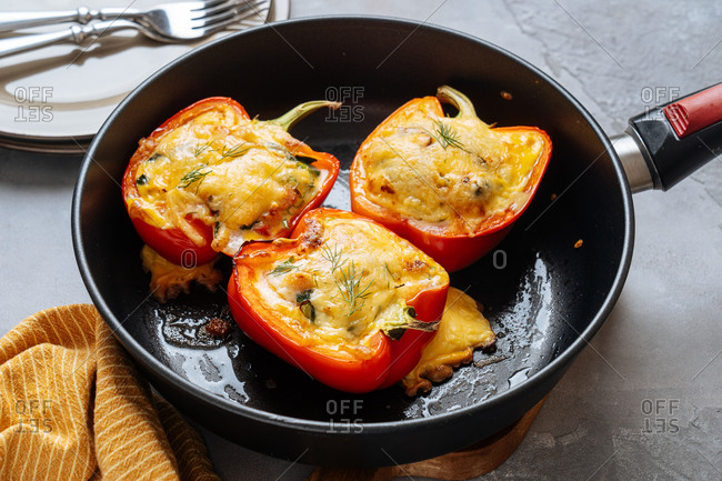 Cheesy stuffed peppers in a frying pan