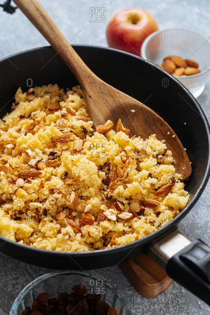 Overhead view of skillet with millet and almonds