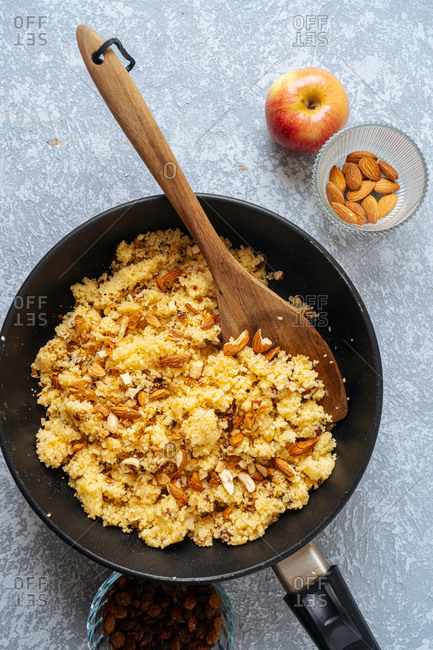 Top view of skillet with millet and almonds