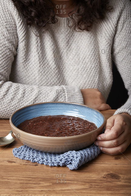 Person eating champorado for breakfast