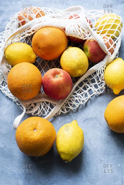 Fruits lying in white net bag