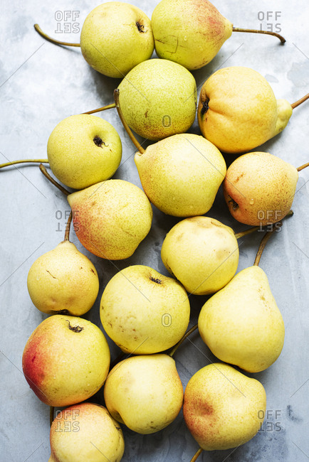 Yellow pears on light background