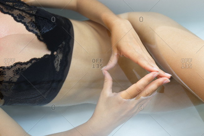 Overhead view of a woman wearing lingerie in bath