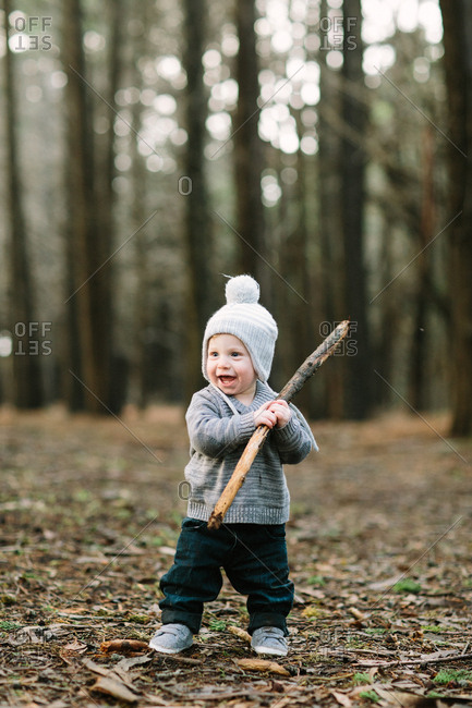 Toddler boy in woods with winter hat