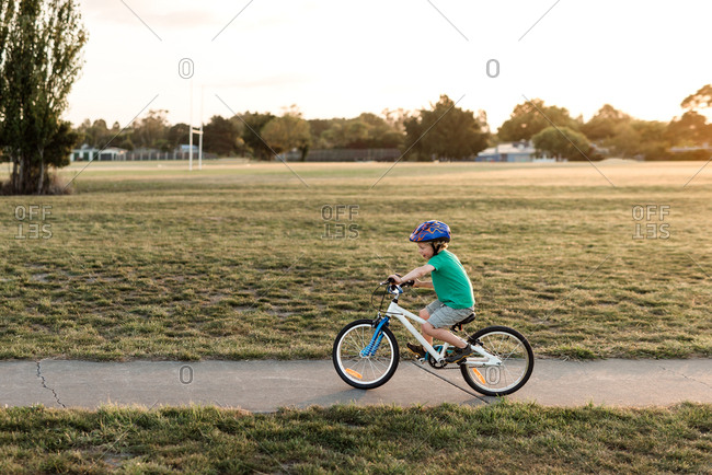 Young child riding bike on path
