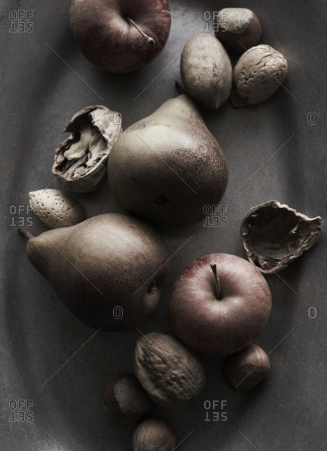 Pears apples nuts in pewter bowl up close