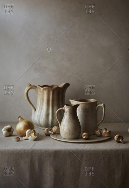 Still life of Ironstone ceramics with onions garlic and mushrooms