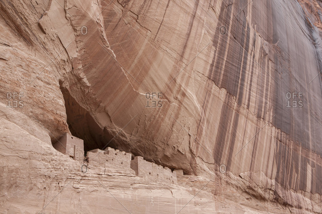 Prehistoric ruins built into a cliff in Canyon de Chelly, Arizona.