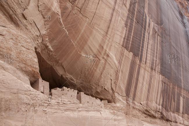 Prehistoric ruins built into a cliff in Canyon de Chelly, Arizona.