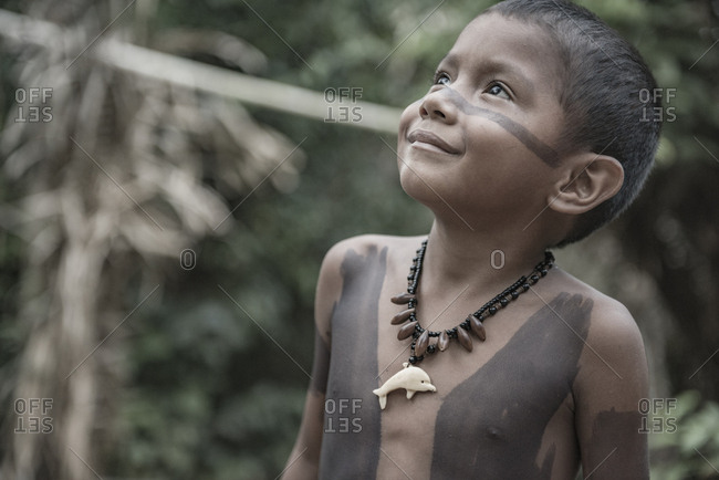 Brazil, State of Amazonas - August 13, 2016: A cute Brazilian Indian with body and face painted