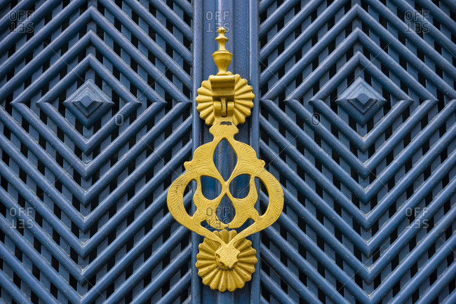 Colonial blue door with yellow door knocker