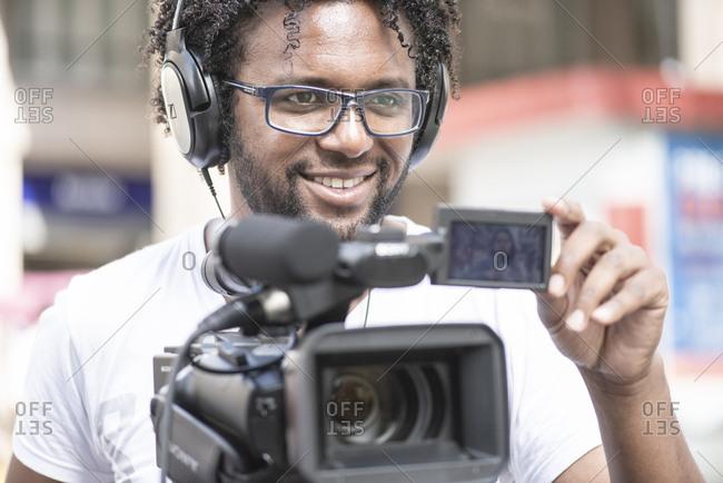 Brazil, State of Rio Grande do Sul, Porto Alegre - October 28, 2015: TV cameraman working in the streets