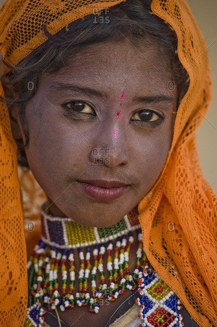 India, Rajasthan, Jaisalmer - August 16, 2011: Young Rajasthani girl with traditional looking