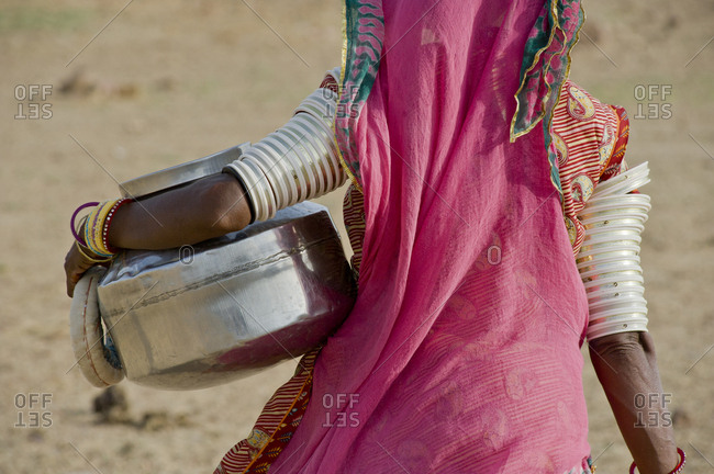 Rajasthani woman carrying a jar in the Thar Desert