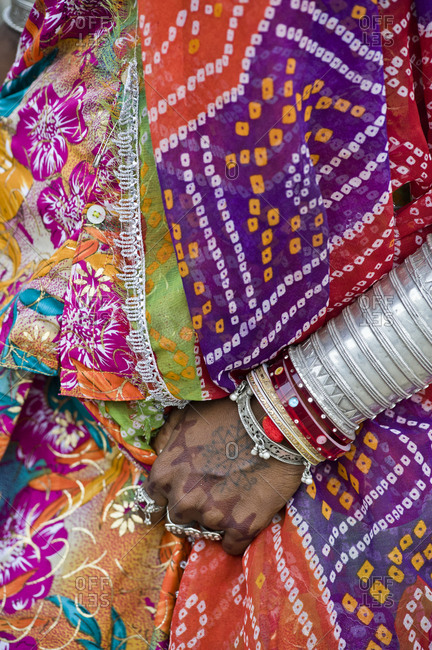 Rajasthani`s woman with traditional and colorful clothes and jewelry