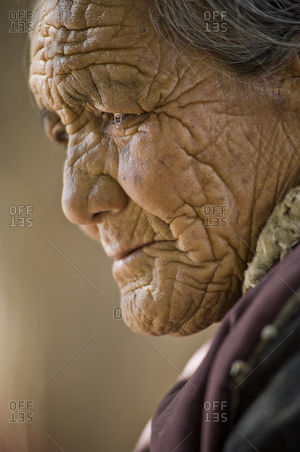 Leh, Jammu and Kashmir, India - July 24, 2011: Buddhist faithful with wrinkled face