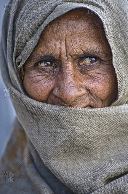 Leh, Jammu and Kashmir, India - July 24, 2011: Woman with face covered in the streets of Leh