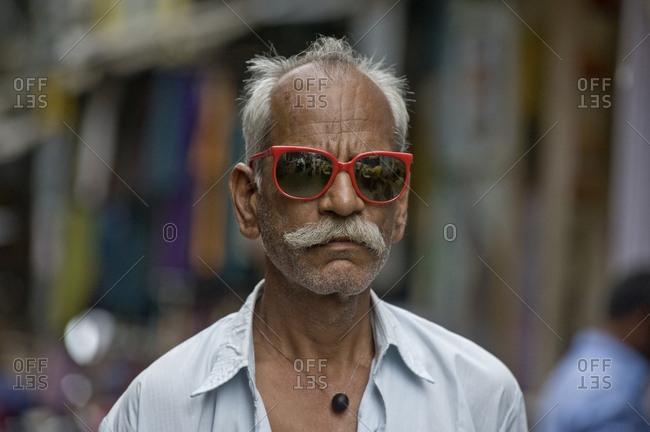 India, Rajasthan, Pushkar - August 11, 2011: Rajasthani man with sunglasses and typical mustache