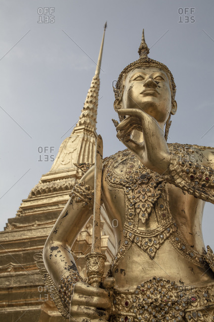 Golden statue of Kinnari inside the Grand Palace