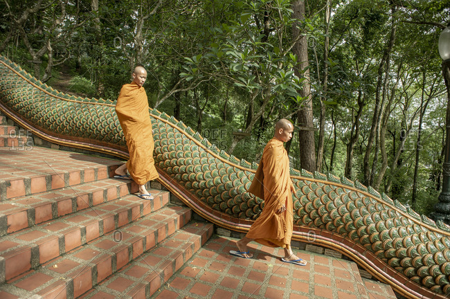 Thailand, Chiang Mai - May 18, 2011: Monks going down the Naga staircase at Wat Phra That Doi Suthep