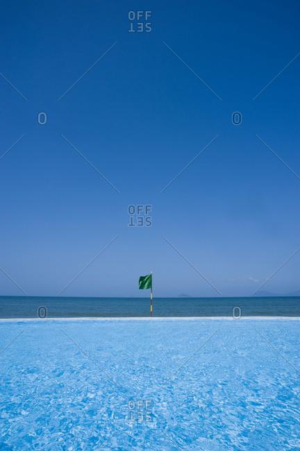 Beach resort pool and blue skyline