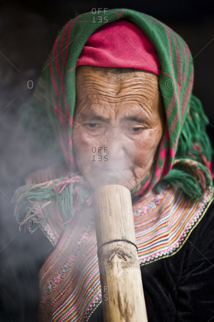 Vietnam, Lao Cai - March 13, 2011: Old lady smoking Thuoc Lao, a traditional Vietnamese custom