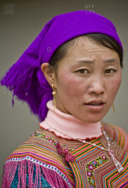 Vietnam, Lao Cai - March 13, 2011: Portrait of a Hmong woman wearing traditional colorful clothes