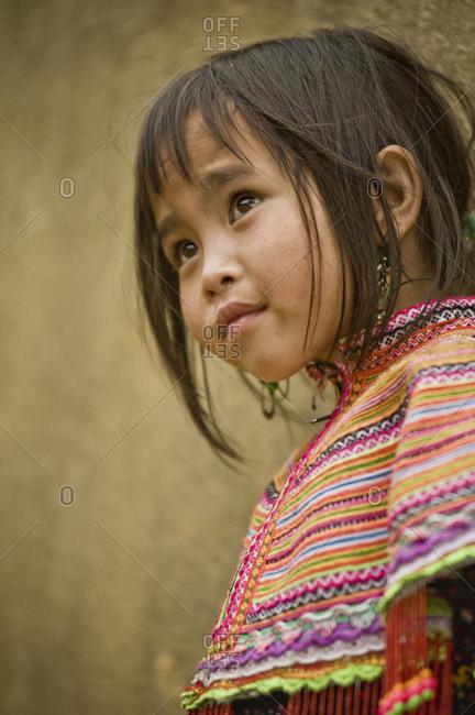 Vietnam, Lao Cai - March 13, 2011: Portrait of a beautiful little Hmong girl